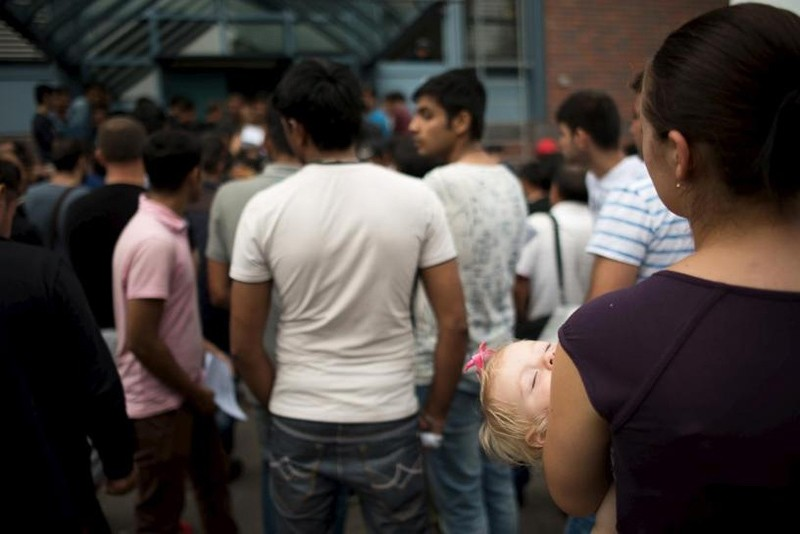 Asylum seekers wait in front of the Federal Office for Migration and Refugees (Reuters File Photo)