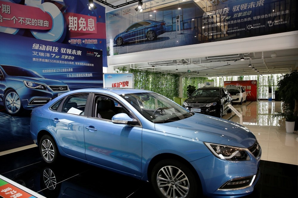 Automobiles are displayed at a electric car dealership in Shanghai.