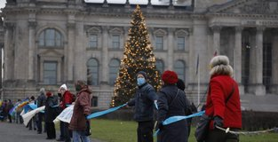 Hundreds form human chain to protest military spending in Germany