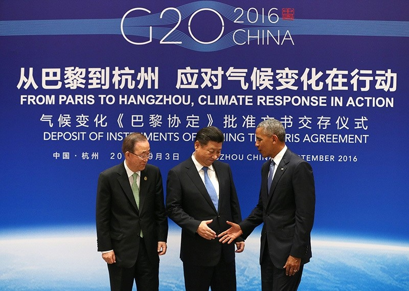 China's Xi Jinping (C), US President Barack Obama (R) and UN Secretary General Ban Ki-moon shake hands during a joint ratification of the Paris climate change agreement ceremony at West Lake State Guest House in Hangzhou on Sept 3, 2016. (AFP Photo)