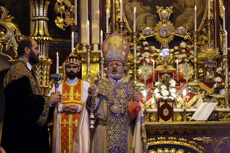 Archbishop Aram Ateu015fyan (C) holds a mass at Surp Asdvadzadzin Patriarchal Church in Istanbul April 24, 2015 (Reuters)
