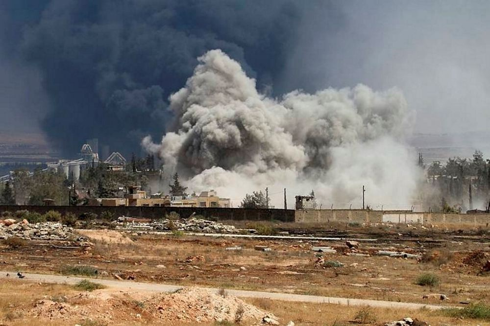 Smoke billows following airstrikes by Assad forces on opposition positions during intense fighting in Aleppo.