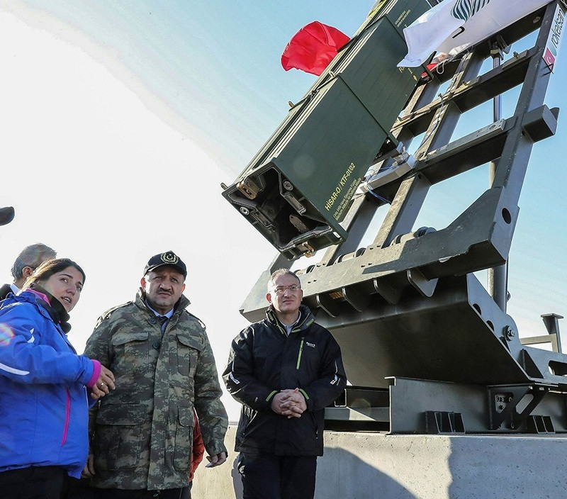 Defense Minister Fikri Iu015fu0131k is being briefed regarding Hisar-O's test launch next to the rocket launcher, on Dec. 08, 2016, in central province of Aksaray. (AA Photo)