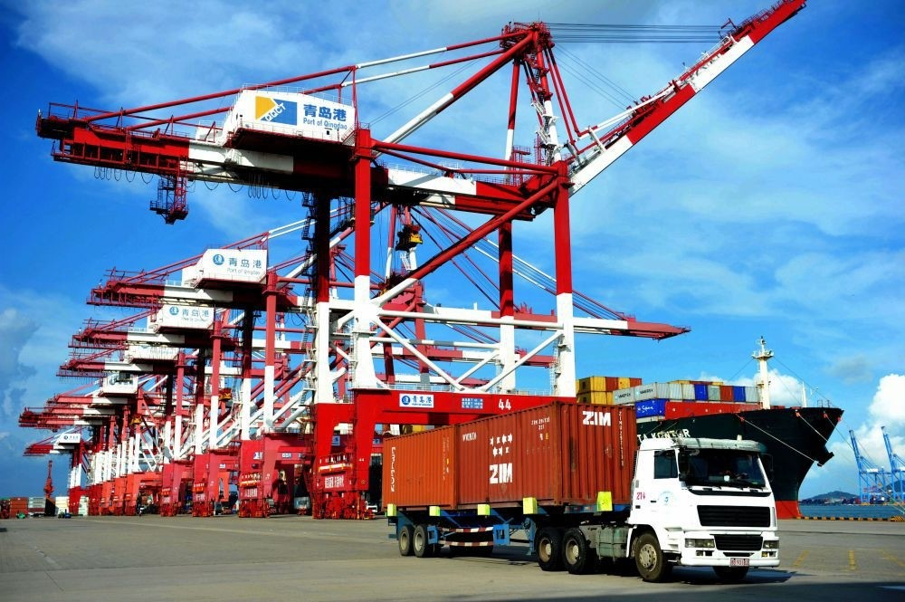A truck transports containers at a port in Qingdao, eastern China's Shandong province.