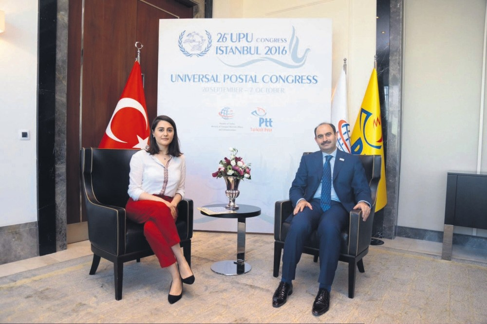Post and Telegraph Organization (PTT) General Manager Kenan Bozgeyik (R) speaks to Daily Sabah's Merve Baran about the objectives of 26th Universal Postal Congress