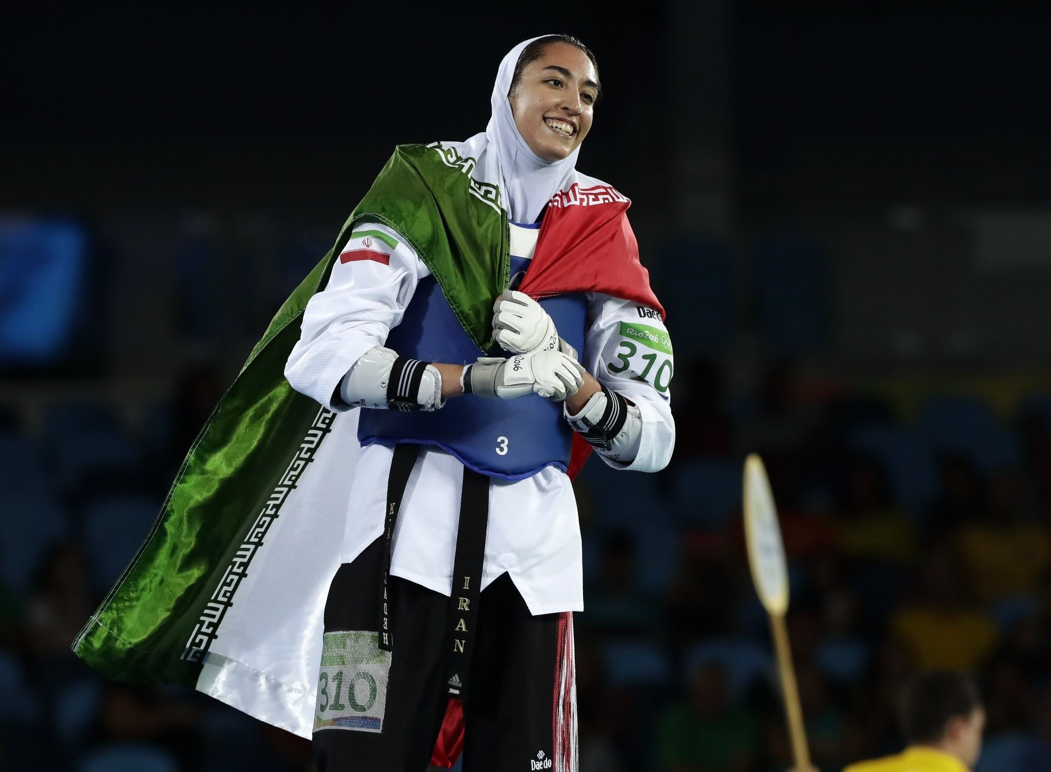 Kimia Alizadeh Zenoorin, of Iran, celebrates after winning a bronze medal in women's 57-kg taekwondo competition at the 2016 Summer Olympics in Rio de Janeiro, Brazil, Thursday, Aug. 18, 2016. (AP Photo)