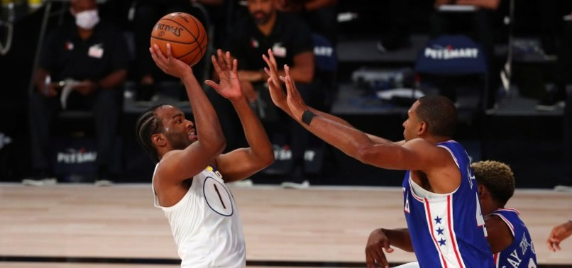 PACERS RALLY TO DEFEAT 76ERS BEHIND WARREN'S CAREER-HIGH 53