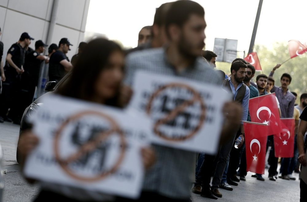 People protesting in front of the German Consulate in Istanbul, Turkey, June 2, 2016, against German parliament's decision to adopt a resolution on the 1915 Armenian incidents.