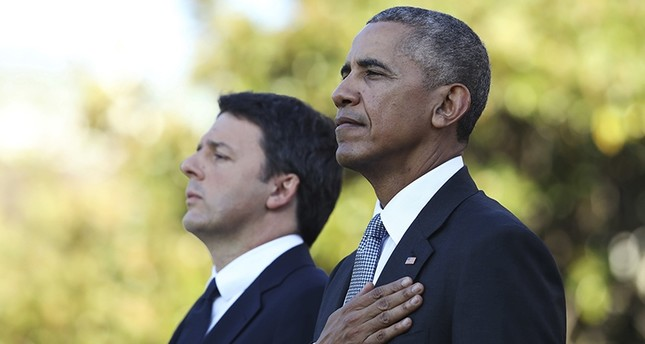 President Barack Obama and Italian Prime Minister Matteo Renzi stand at attention as the Star Spangled Banner is played during a state arrival ceremony on the South Lawn of the White House. (AP Photo)