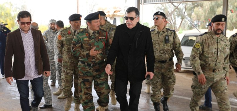 US, LIBYAN GOVERNMENT DISCUSS DISBANDING MILITIAS