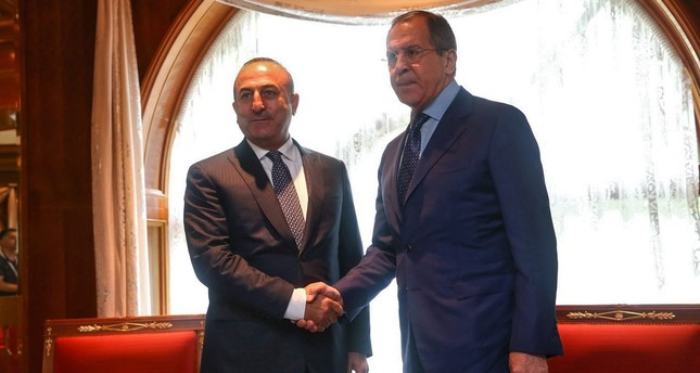 A handout picture released by the Russian Foreign Ministry shows Russian Foreign Minister Sergei Lavrov (R) meeting with Turkish Foreign Minister Mevlut Çavuşoğlu (EPA Photo)