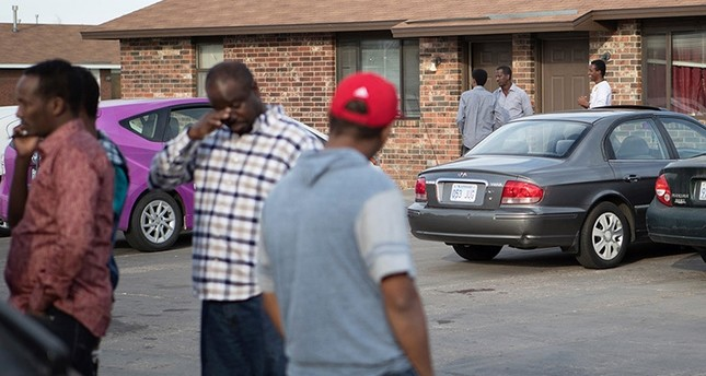 People stand outside an Islamic mosque located within an apartment complex, which federal authorities allege was to be targeted in a bomb plot by three Kansas men, is seen in Garden City, Kansas, U.S. October 14, 2016. (Reuters Photo)