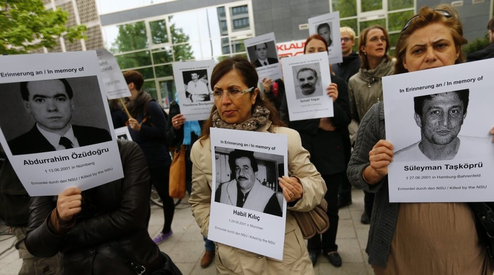 Demonstrators carry photos of NSU victims during a trial on the neo-Nazi gang in Germany. The gang is implicated in the murders of eight Turks, a Greek and a German policewoman.