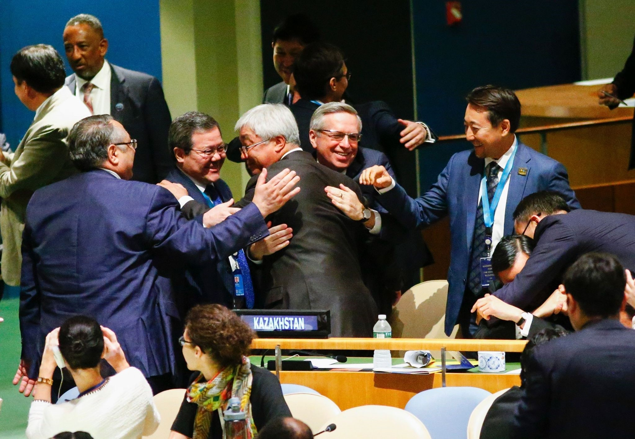 Kazakhstan's FM Erlan Idrissov (C) reacts after Kazakhstan won a seat during the Election of five non-permanent members of the Security Council at the United Nations in New York on June 28 2016. (AFP Photo)