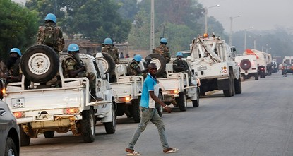 pHeavy gunfire erupted Saturday at a military camp in Abidjan, Ivory Coast's largest city, witnesses said, a sign that a mutiny by disgruntled soldiers could be escalating despite government...