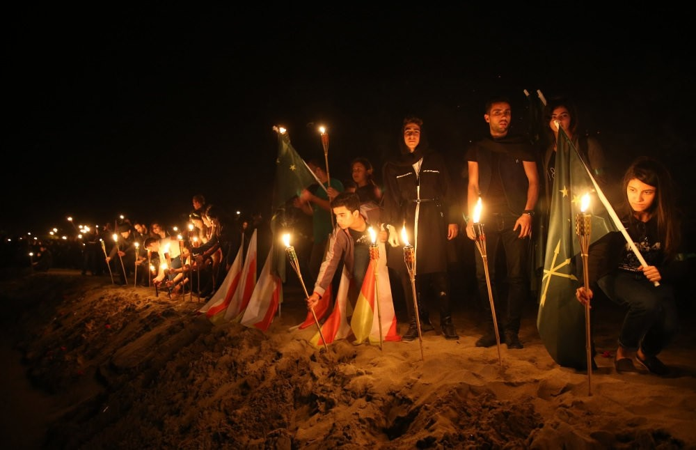Circassian community members light fires on the beach of a village in Kocaeli in the northwest, one of the first places they settled in Turkey after the exile, to remember the anniversary of the exile.
