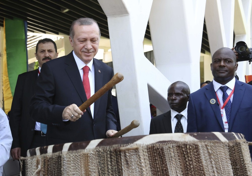 Turkish President, Recep Tayyip Erdou011fan, beats a traditional drum during the official welcoming ceremony at State House in Dar es Salaam Tanzania.