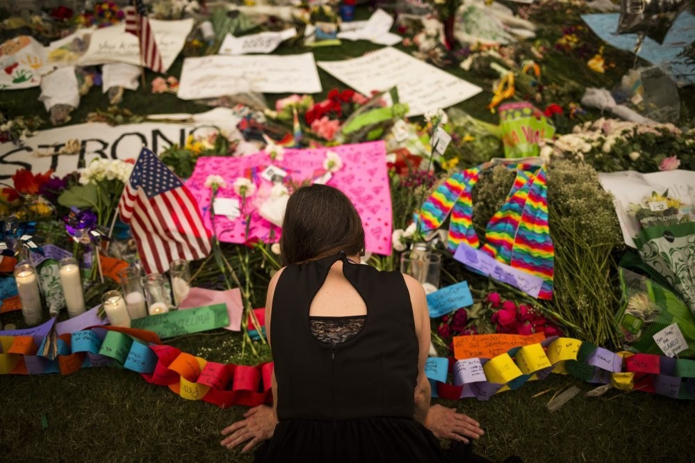 A woman visits a memorial in honor to the victims of the Orlando mass shooting outside the Dr. Phillips Center for the Performing Arts in Orlando, Florida, June14.