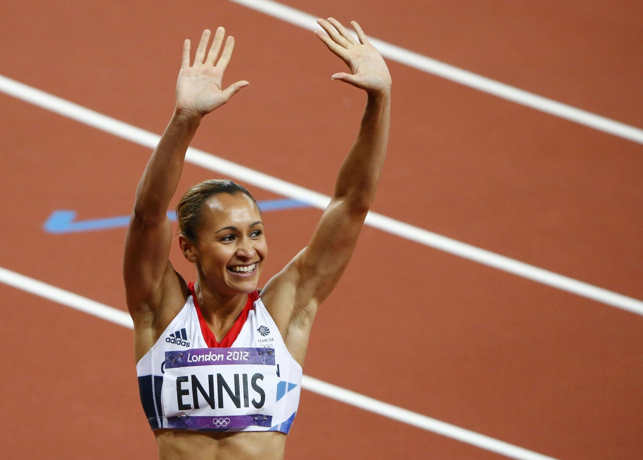 Britain's Jessica Ennis celebrates after finishing first in her women's heptathlon 200m heat at the London 2012 Olympic Games at the Olympic Stadium August 3, 2012. (REUTERS Photo)