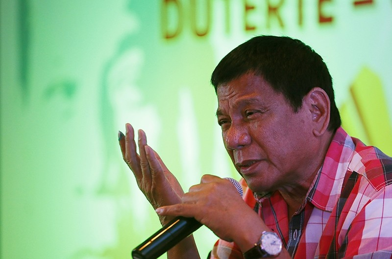 In this Monday, May 9, 2016 photo, front-running presidential candidate Mayor Rodrigo Duterte answers questions from the media during a news conference shortly after voting at his hometown in Davao city in southern Philippines (AP Photo)