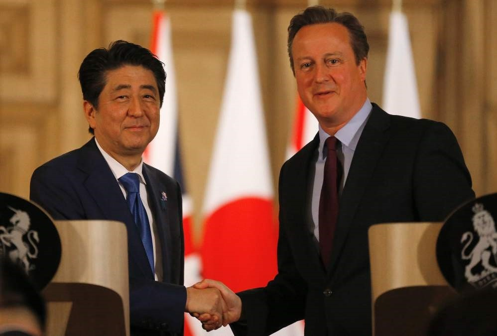 Japanese Prime Minister Shinzo Abe (L) and British Prime Minister David Cameron attend a joint press conference following a meeting in central London.