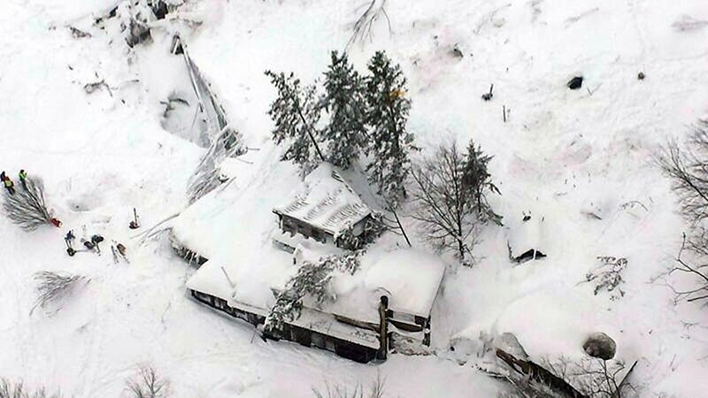 A handout photo made available by the Italian Fire Department shows an aerial view of the avalanche-hit hotel Rigopiano in the town of Farindola in Abruzzo region, Italy, 19 January 2017. (EPA Photo)