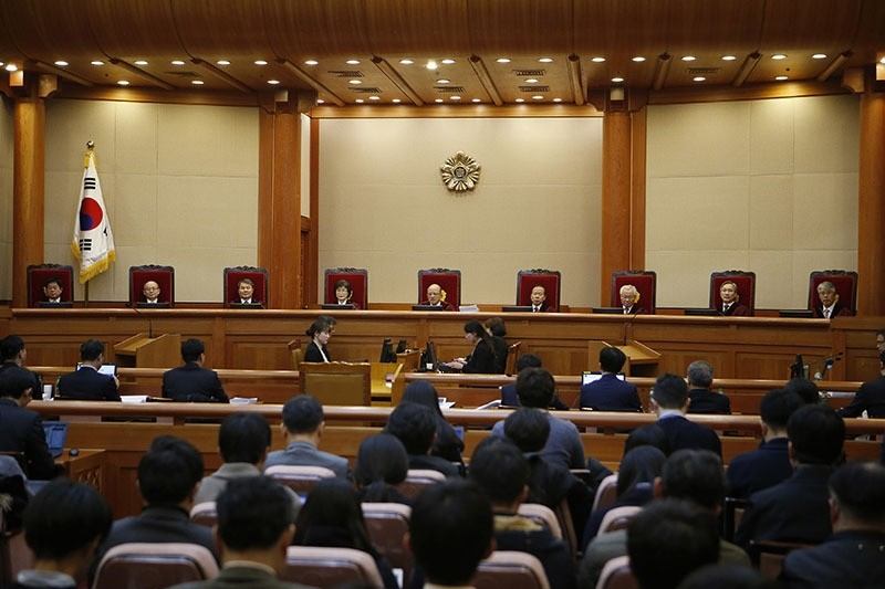 Nine judges sit during the first hearing arguments for South Korean President Park Geun-hye's impeachment trial at the Constitutional Court in Seoul, South Korea, Tuesday, Jan. 3, 2017. (AP Photo)