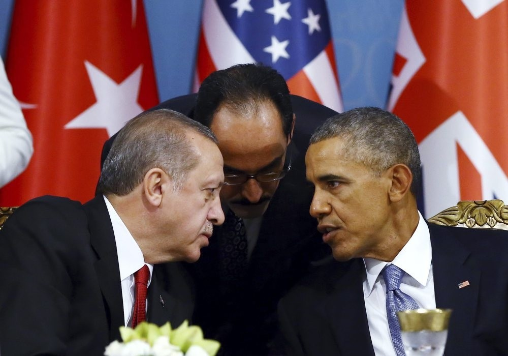 Erdou011fan (L) talks with Obama (R) during a session of the G20 Summit in Antalya, Turkey, Nov. 15, 2015.