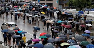 Hundreds of thousands turn out for peaceful HK protest