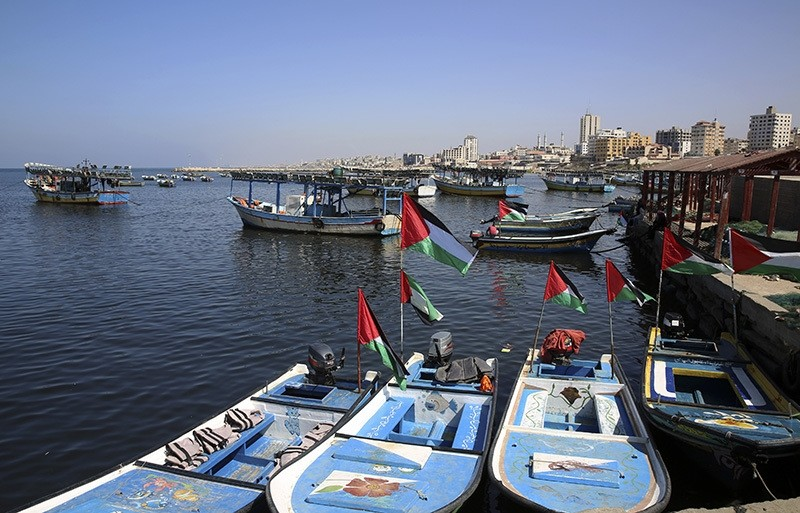 Fishing boats, decorated with national flags, await the arrival of an international boat trying to break Israel's blockade of the Gaza Strip, at the fishermen port in Gaza City, Thursday, Oct. 6, 2016. (AP Photo)
