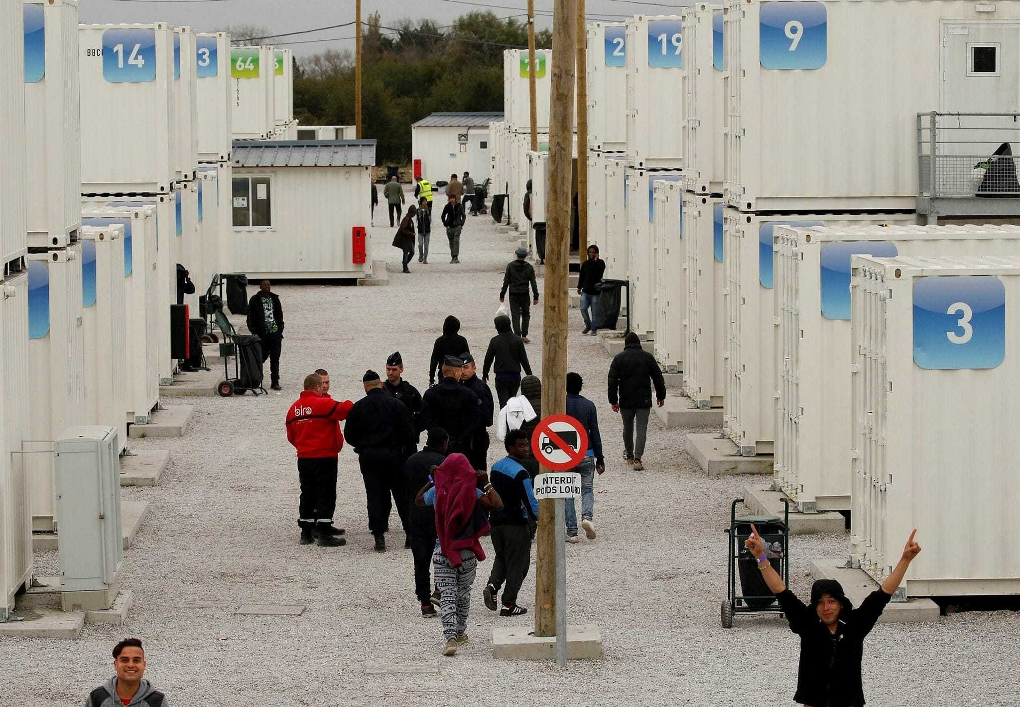 Around 1500 migrant minors in Calais inside the containers before leaving for one the reception centers in France, Nov. 1.