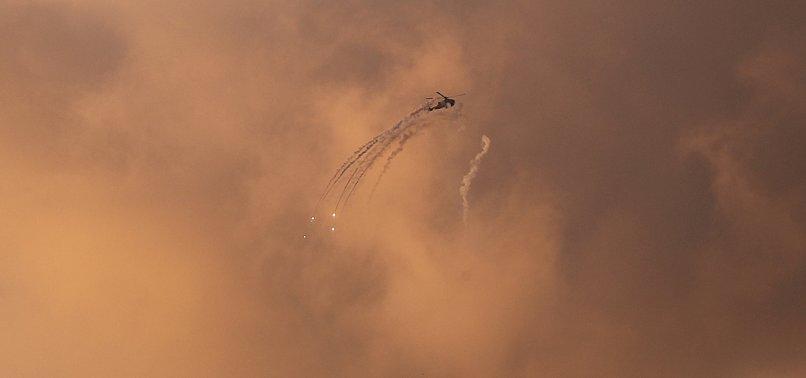 ISRAELI WARPLANES STRIKE HAMAS POSITIONS ACROSS BLOCKADED GAZA