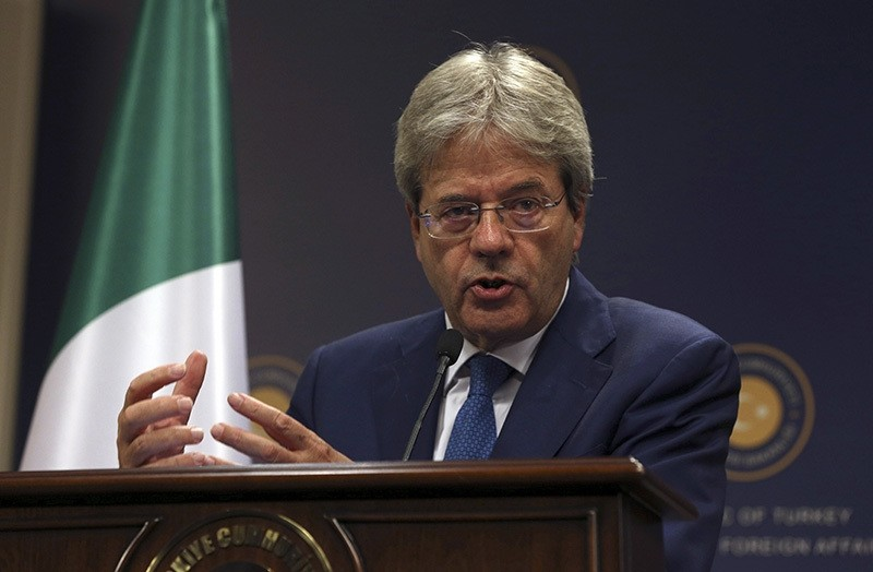 In this Thursday, Oct. 6, 2016 file photo, Italian Foreign Minister Paolo Gentiloni talks during a joint press conference with FM Mevlu00fct u00c7avuu015fou011flu (AP Photo)