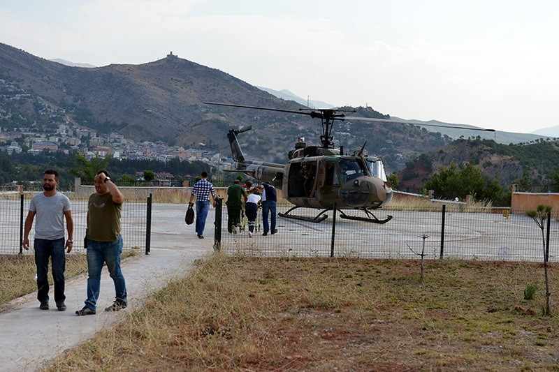 Wounded police officers in Nazu0131miye district were transferred to hospital in Elazu0131u011f province with helicopters in the morning. (AA Photo)