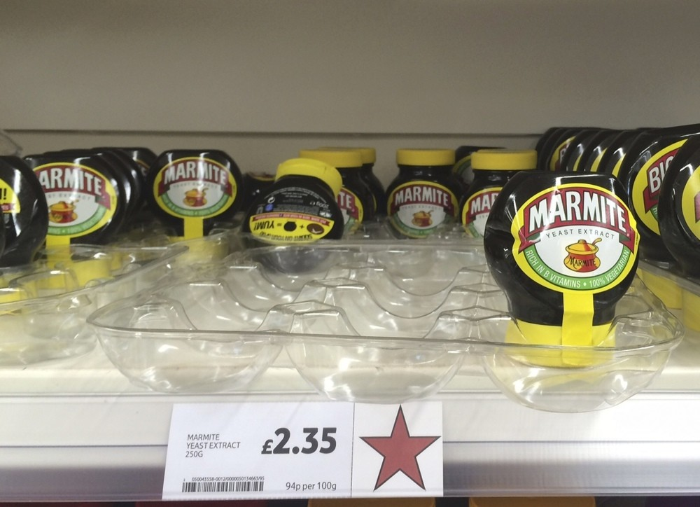 Jars of Marmite, a brand of Unilever, are displayed for sale on a shelf at a Tesco supermarket in Basildon, Britain.