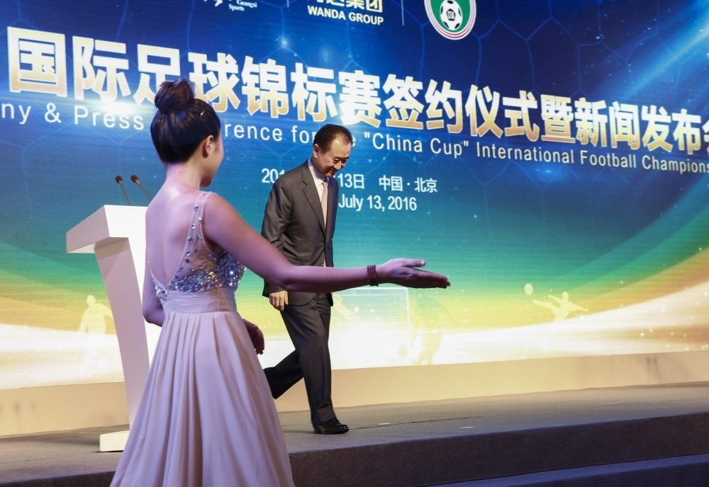 Wang Jianlin, Chairman of Chinau2019s Wanda Group walks off the stage after giving a statement during ceremonies to mark a signing ceremony and press conference for the u2018China Cupu2019 international football tournament in Beijing.