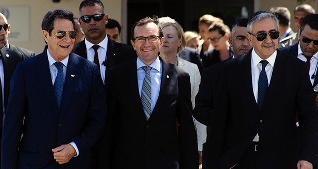 Anastasiades (L), Akıncı (R) and Eide (C) arrive to give a press conference following a meeting on the ongoing peace talks on Sept. 14, 2016 at the now defunct Nicosia airport in the UN-controlled buffer zone. (AFP Photo)