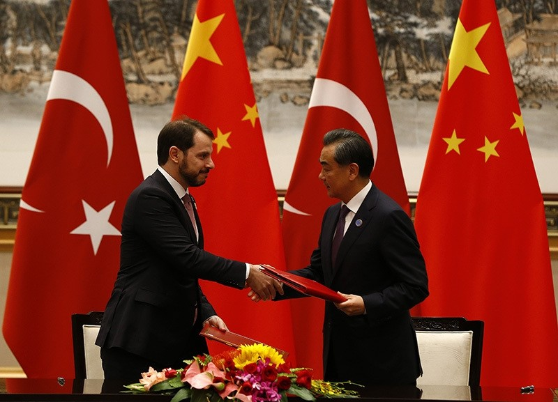 Turkish Energy Minister Berat Albayrak (L) and Chinese Foreign Minister Wang Yi shake hands during the signing ceremony. (AA Photo)