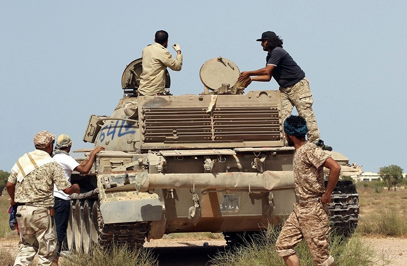 Forces loyal tou00a0Libya's Government of National Unity (GNA) are seen around a tank on July 2, 2016 as they take position to hit Daesh targets in Sirte. (AFP Photo)
