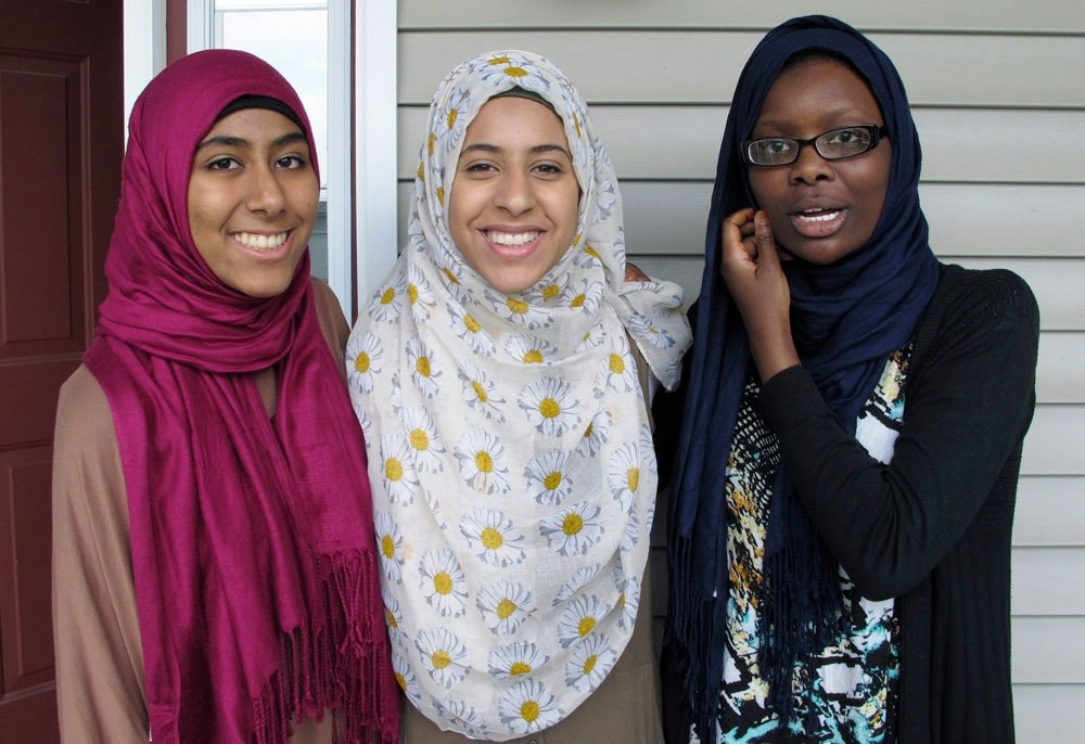 In this July 7, 2016 photo, Kirin Waqar, Lena Ginawi and Hawa Adam, members of Muslim Girls Making Change, pose for a photo in South Burlington, VT. (AP Photo)