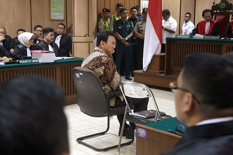 Jakarta Governor Basuki Tjahaja Purnama, better known by his nickname Ahok, sits in the defendant's chair during his trial at the North Jakarta District Court in Jakarta, Dec. 13, 2016. (AFP Photo)