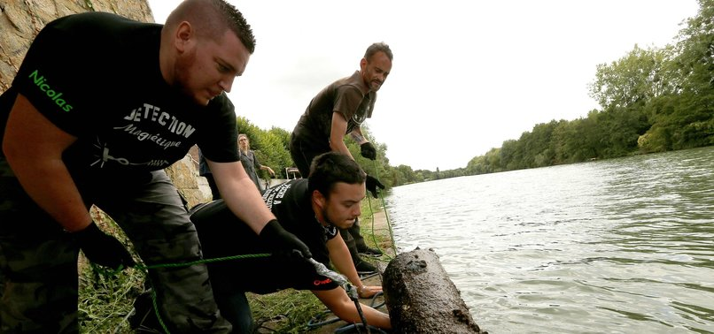 MAGNET FISHERS CLEAN UP FRENCH RIVERS AMID EXPLOSION CONCERNS