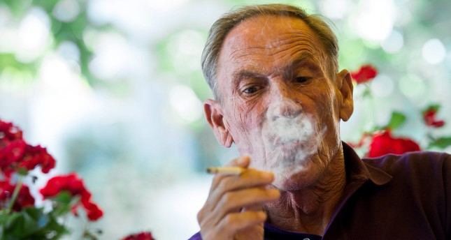 FC Lugano presents the new coach Zdenek Zeman, pictured while smoking, in Lugano southern part of Switzerland, on Wednesday June 17 2015. (EPA Photo)
