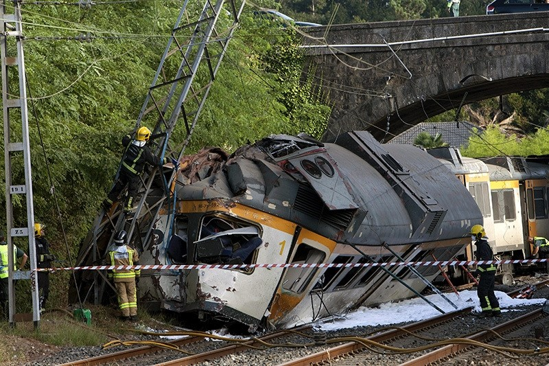 Spanish emergency services members work at the site where a train derailed near resulting in the death of at least three people and several others injured, in the northwestern province of Galicia, Spain, Sept. 09. (EPA Photo)
