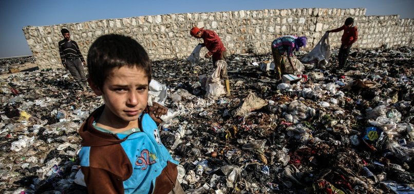 WAR-WEARY SYRIAN CHILDREN EARN THEIR LIVING BY WORKING IN GARBAGE DUMPS