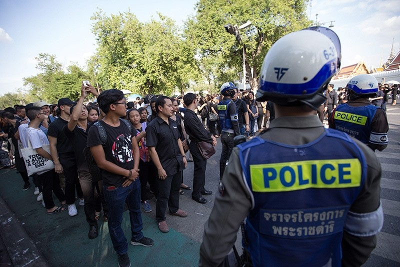 Police officers control the crowd gathering to mourn the late Thai King Bhumibol Adulyadej outside the Grand Palace in Bangkok, Thailand (EPA Photo)