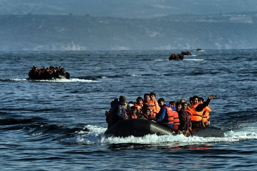 Migrants reach the Greek island of Lesbos after crossing the Aegean sea on Oct. 4 2015.