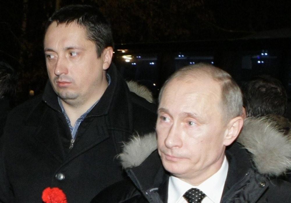 Russian President Vladimir Putin (R) is seen with All-Russian Fan Association head Alexander Shprygin.