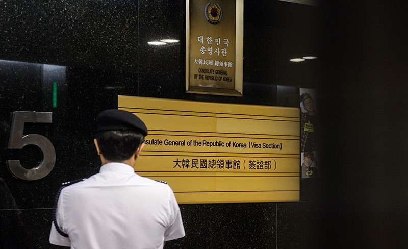 A member of security stands in the lift lobby at the South Korean Consulate in Hong Kong on July 28, 2016 (AFP Photo)