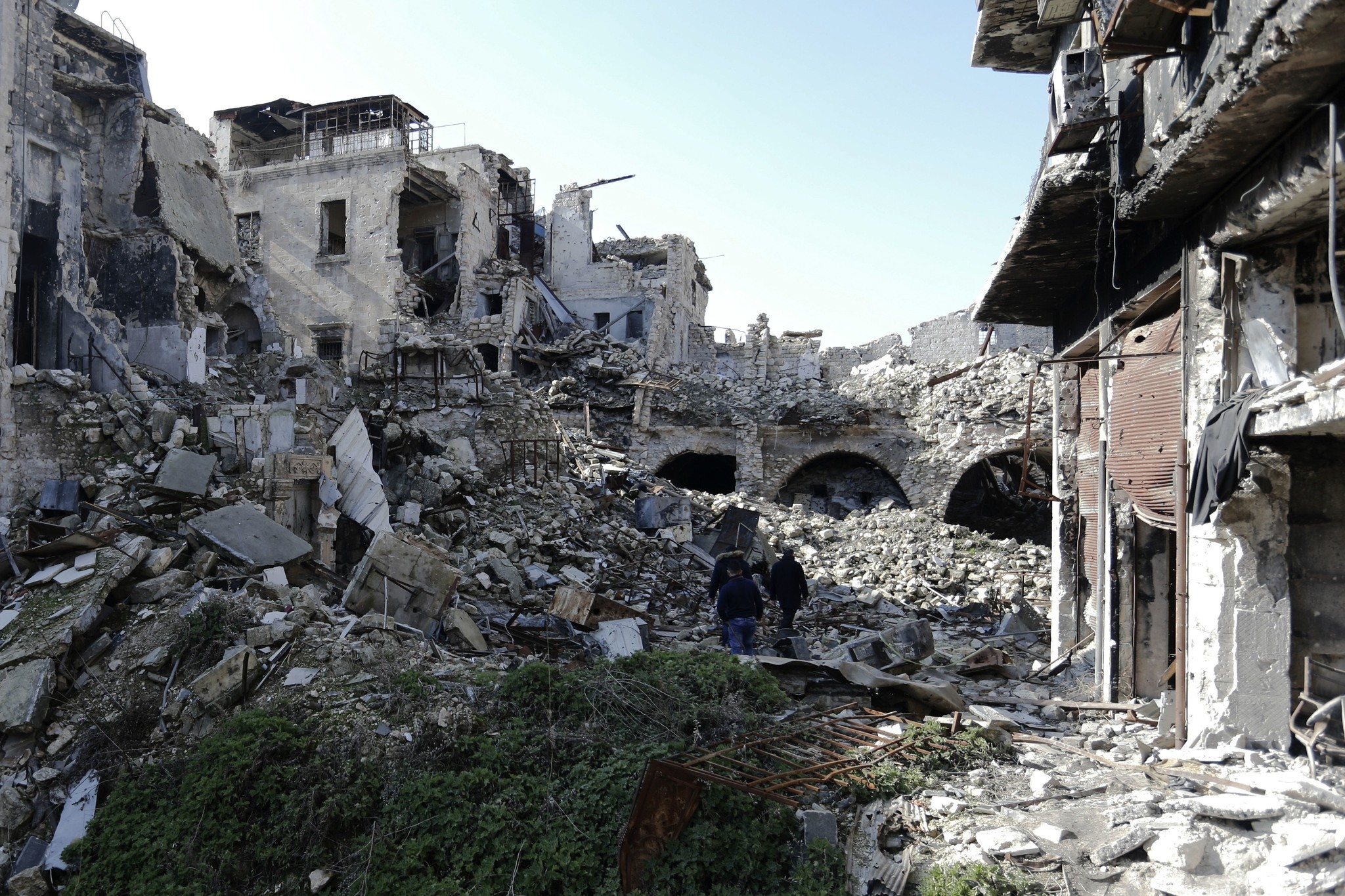 Syrians walk through the destruction in the old city of Aleppo, Syria, Saturday, Jan. 21, 2017. (AP Photo)